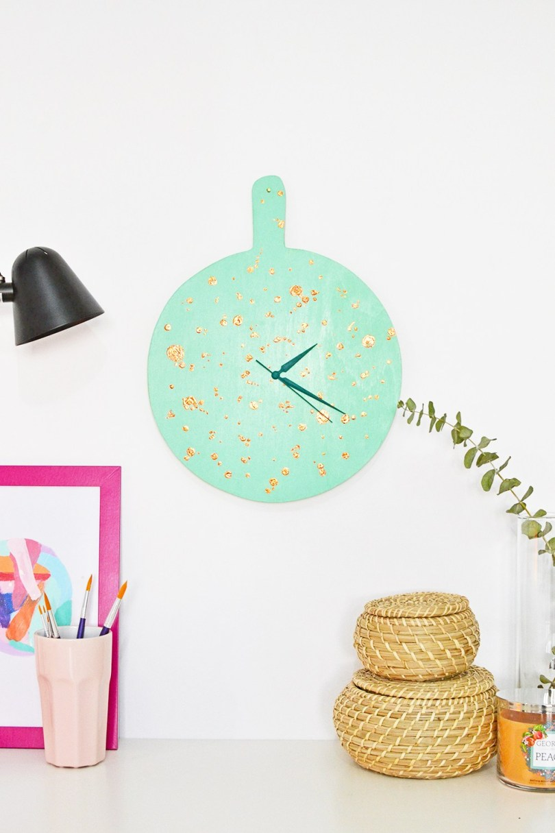 DIY mint and gold speckled clock of a chopping board