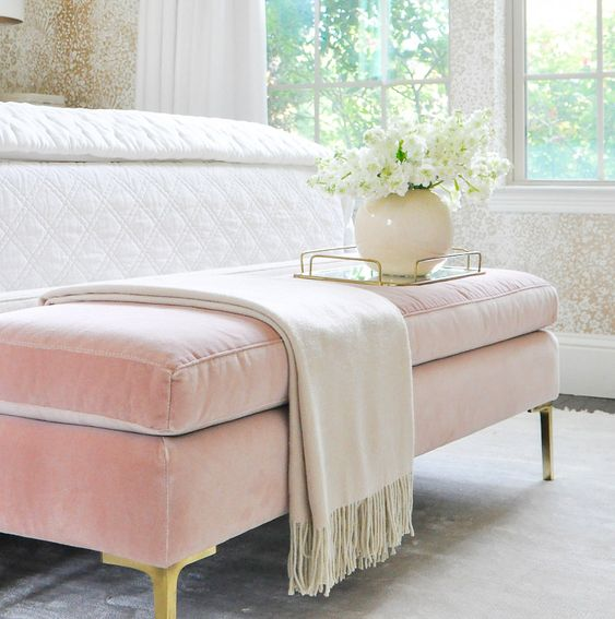 a pink velvet bedroom bench with a storage space inside is a girlish touch to your space