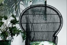 04 a black peacock rattan chair with a bright tropical print pillow is a chic idea for a tropical feel