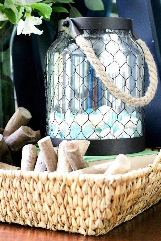 a contemporary black lantern filled with seaglass is ideal to add a beachy feel to the space