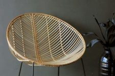 06 a round rattan chair on black metal legs is a stylish addition to many space
