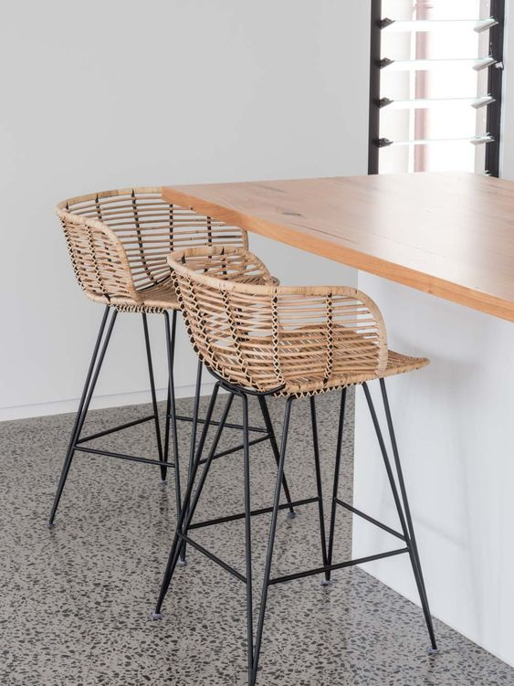 super stylish stools of black metal and rattan will instantly make your breakfast nook or bar space bold and chic