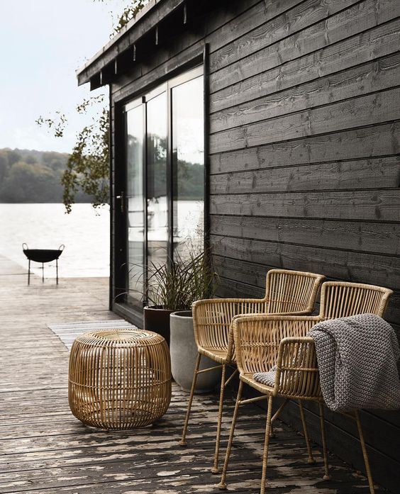 tall rattan chairs and a matching side table can be used both indoors and outdoors