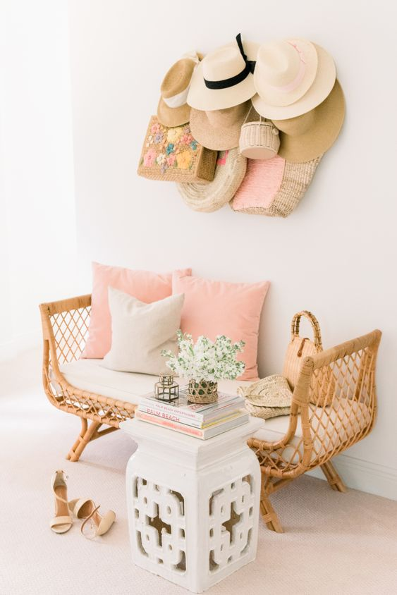 a gorgeous rattan bench with a cushion and some pillows inside will be a perfect fit for any space