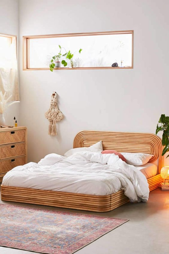 an eye catchy and bold rattan bed with a matching sideboard for a boho bedroom