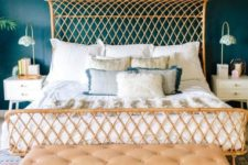 15 a stylish rattan bed wth a curved headboard catches an eye and makes the bedroom unique