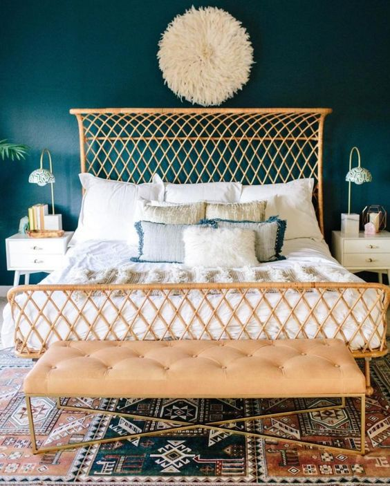 a stylish rattan bed wth a curved headboard catches an eye and makes the bedroom unique