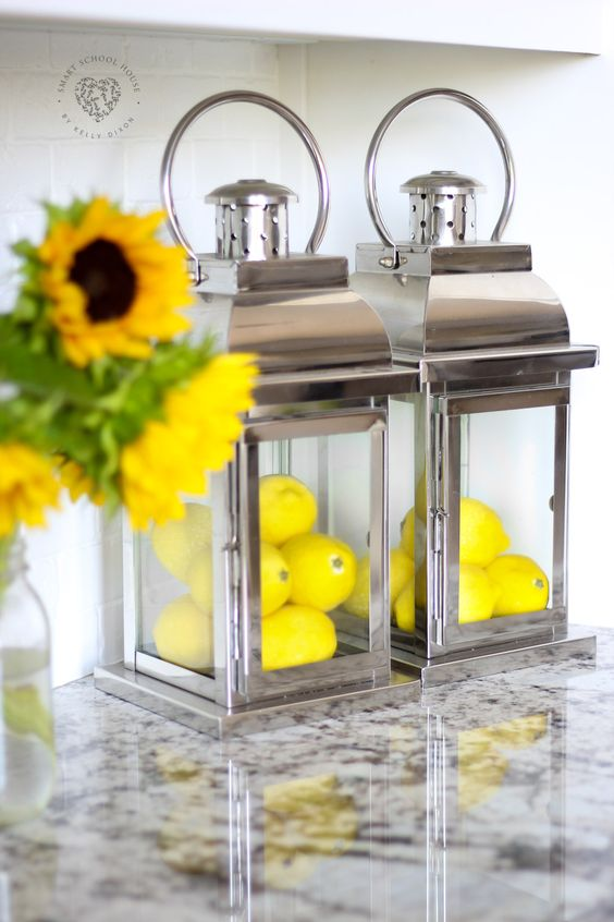 modern metal lanterns filled with lemons can be bright kitchen decorations or summer centerpieces