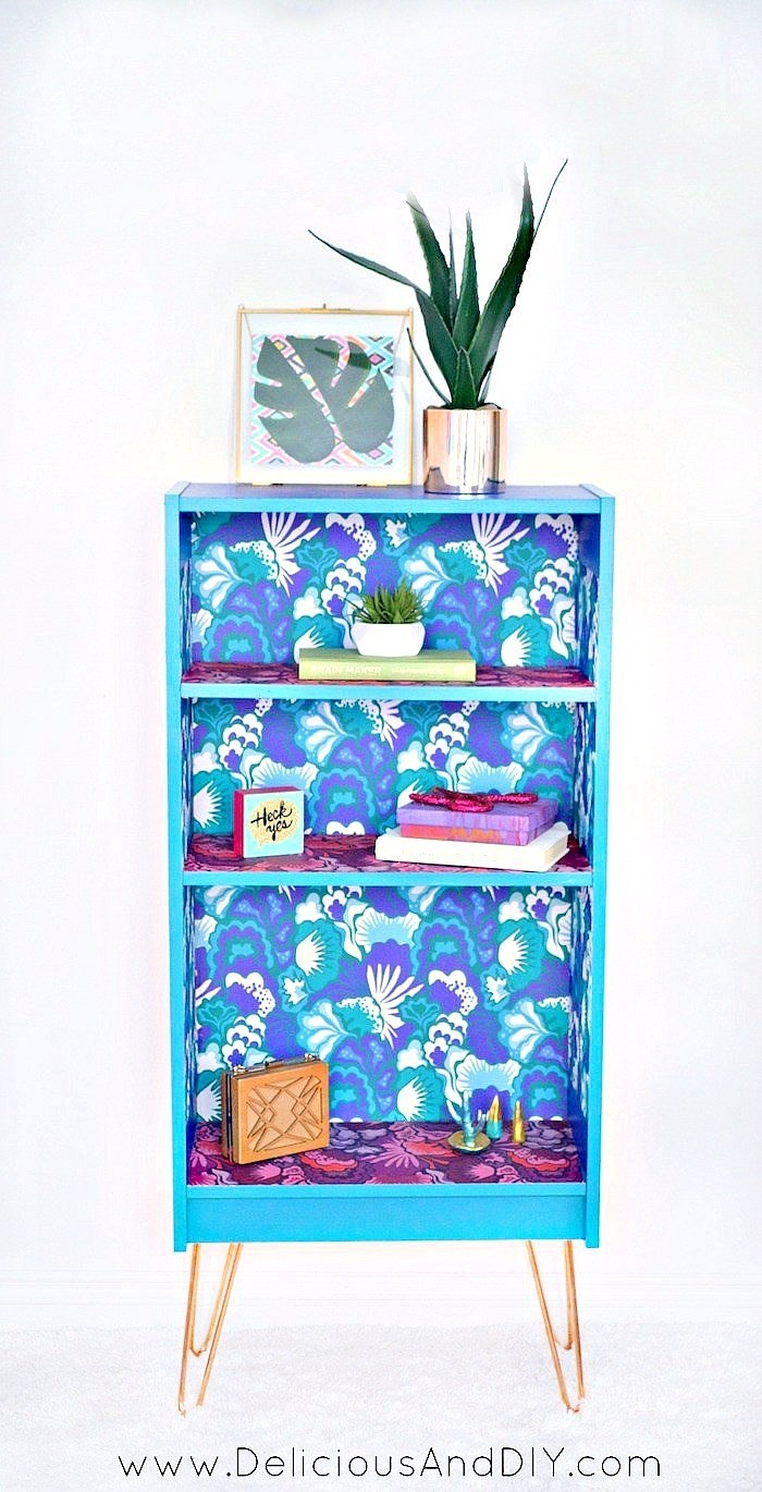 DIY super bright bookcase makeover using wallpapers (via www.deliciousanddiy.com)