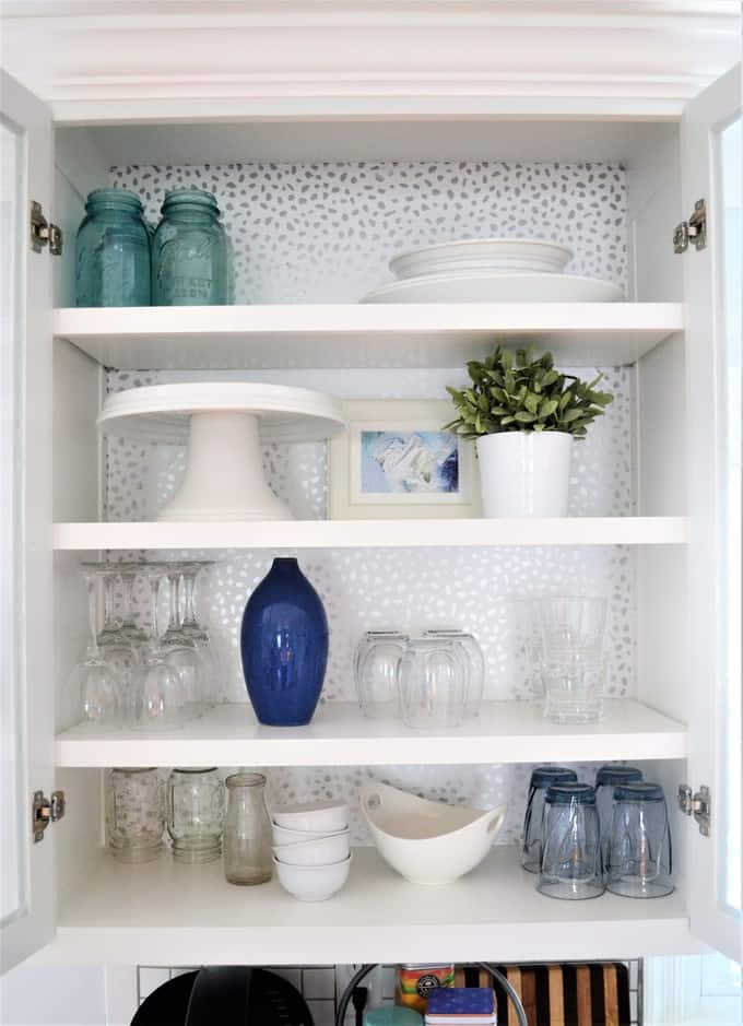 DIY shiny animal print wallpaper kitchen cabinet makeover (via www.burlapandblue.com)