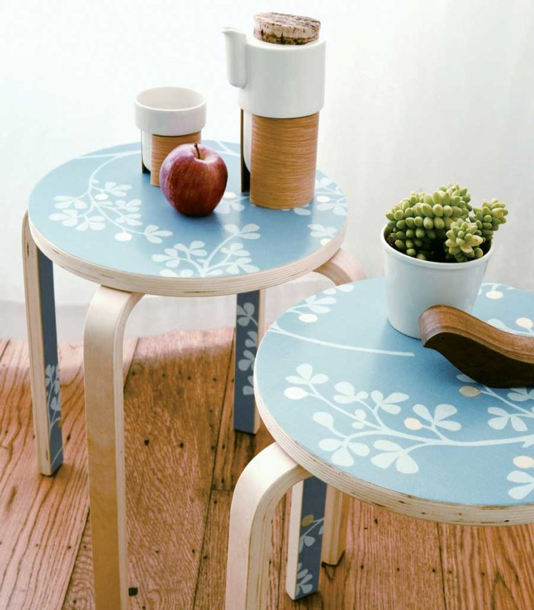 DIY wallpaper side table of plain IKEA stools (via www.motherearthliving.com)