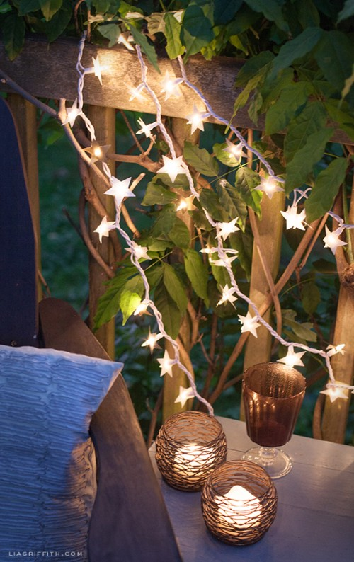 DIY paper foil starry lights for outdoors  (via www.shelterness.com)