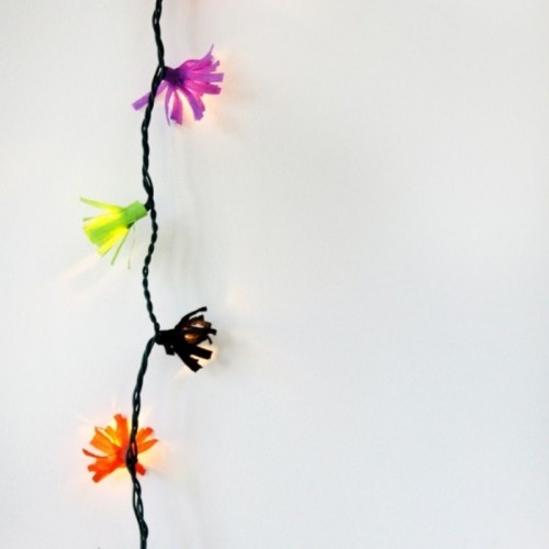 DIY colorful paper fringe lights for any parties and outdoors (via www.shelterness.com)