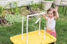 DIY water table with fountain sprayers