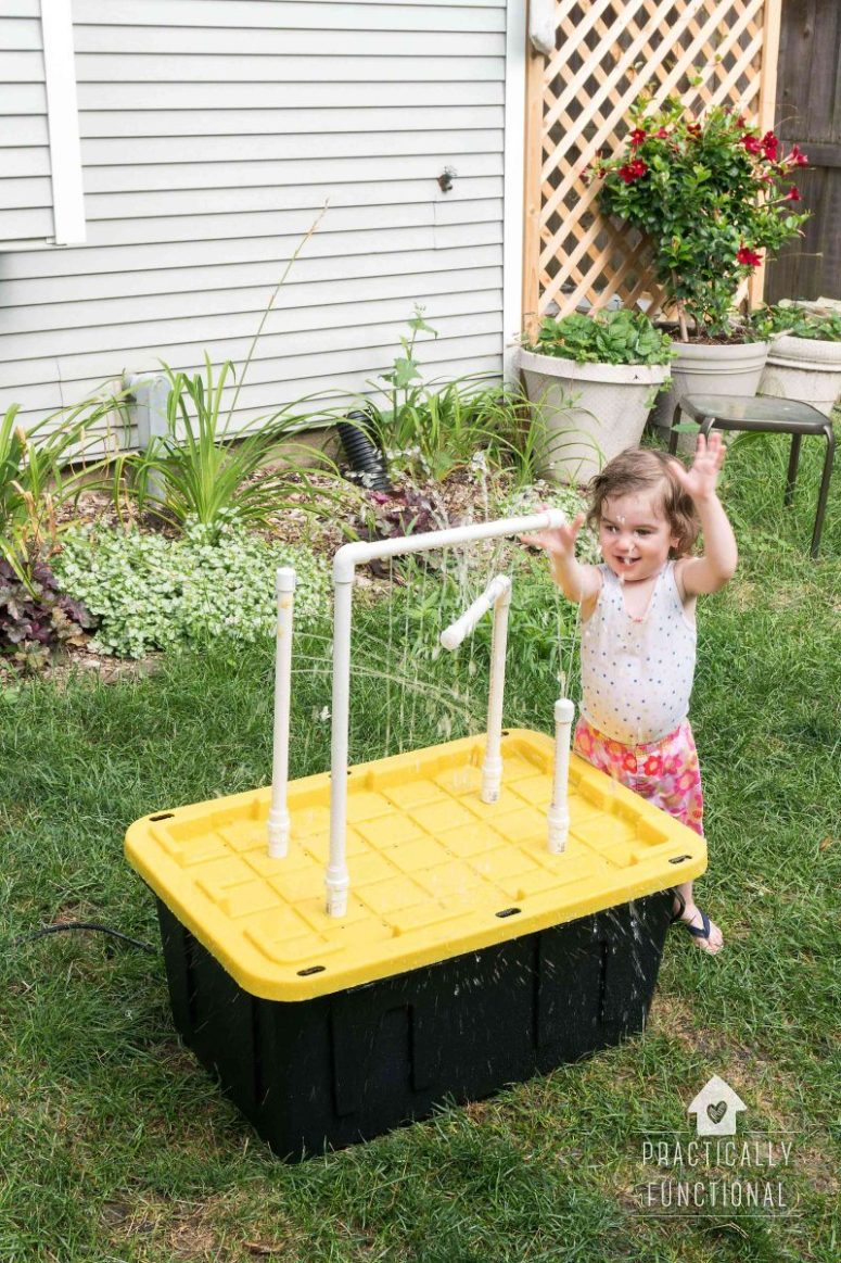 DIY water table with fountain sprayers (via www.practicallyfunctional.com)