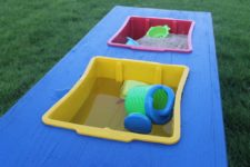 DIY sand and water table in bright and cheerful colors