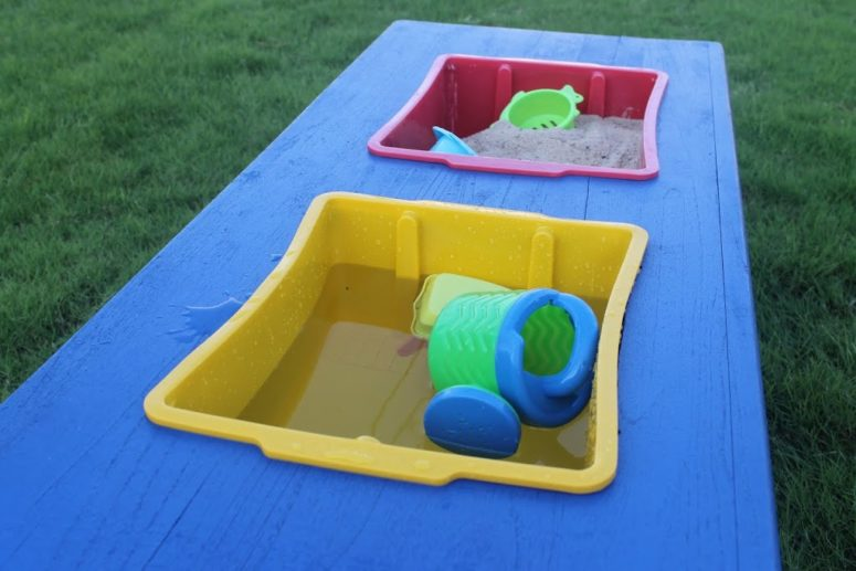 DIY sand and water table in bright and cheerful colors (via www.thechildatheartblog.com)