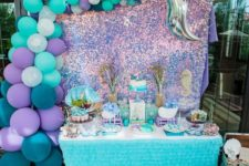 02 a Mermaid baby shower is a gorgeous party theme idea, the best shades are purple, turquoise, teal, navy