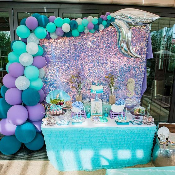 a Mermaid baby shower is a gorgeous party theme idea, the best shades are purple, turquoise, teal, navy