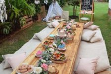 02 a boho baby shower picnic with lots of pillows is a perfect fit for your party