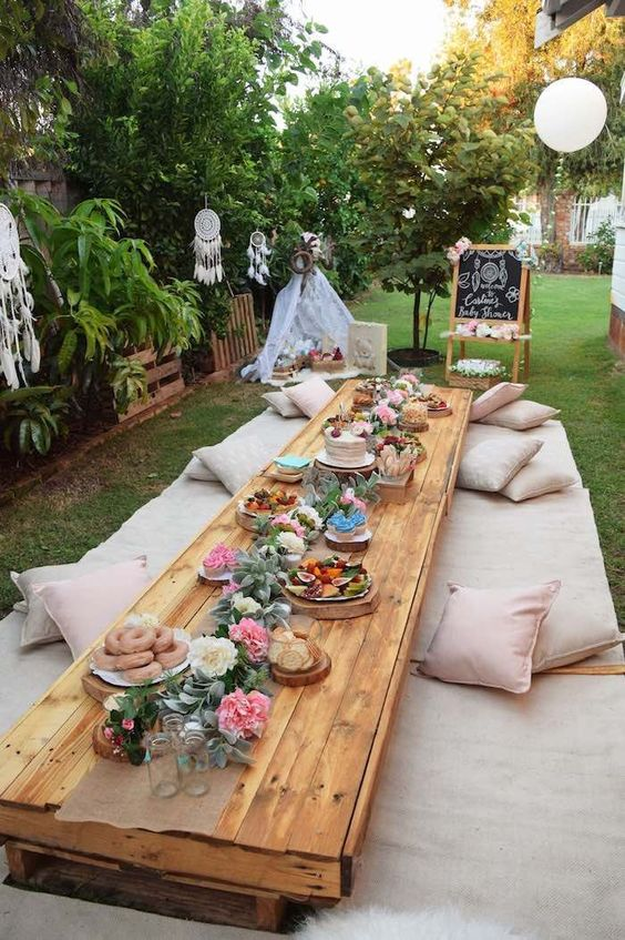 a boho baby shower picnic with lots of pillows is a perfect fit for your party
