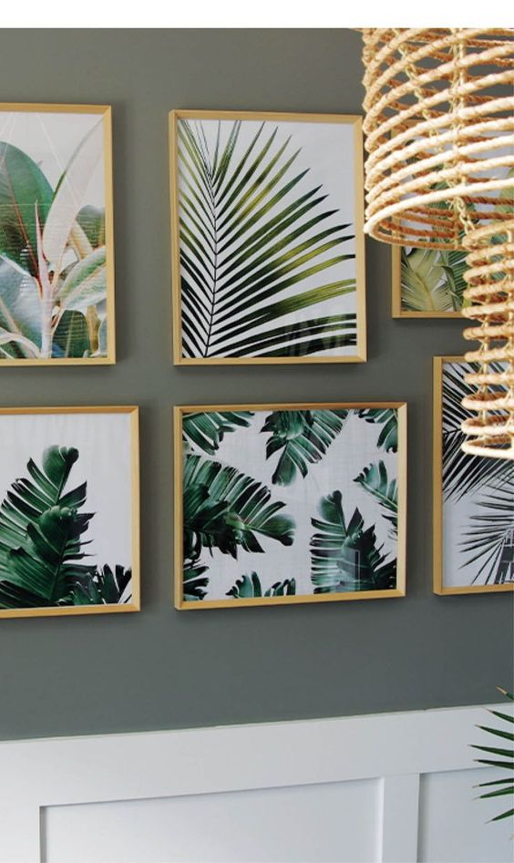 a gorgeous gallery wall with various tropical leaf prints in light colored frames