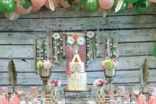 04 a colorful pink and green dessert table with dream catchers, feathers, blooms and lots of balloons