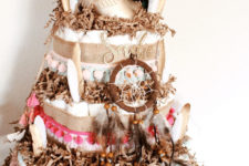 05 a free-spirited diaper cake with dream catchers, feathers, tassels and beads is a fun idea