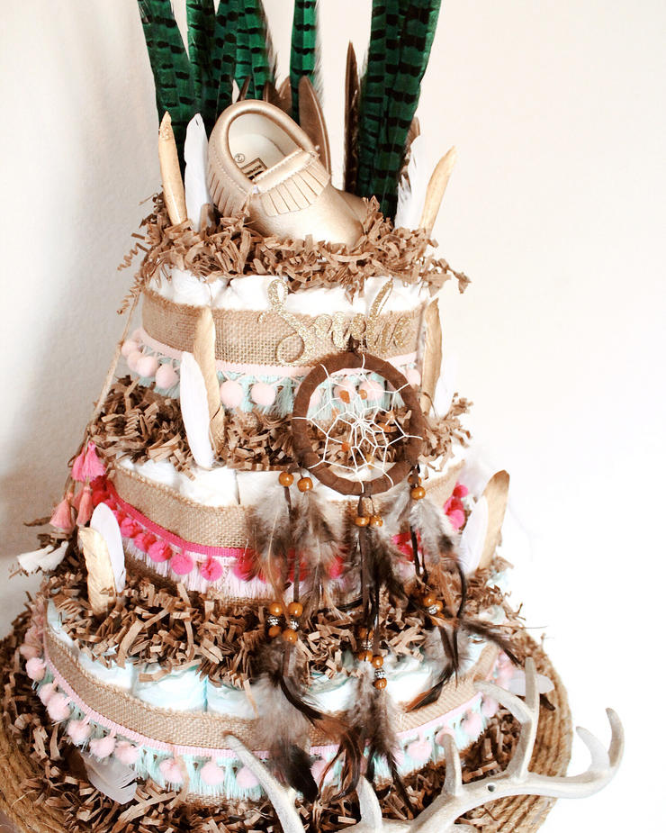 a free-spirited diaper cake with dream catchers, feathers, tassels and beads is a fun idea