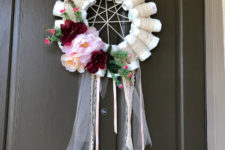 06 a funny diaper dream catcher with ribbons, fresh blooms and greenery is a cool decoration