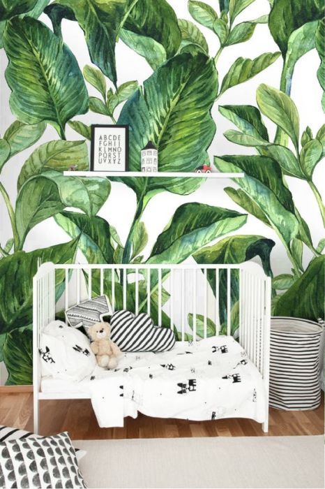 a tropical leaf print wall in the nursery will make it feel organic, natural and summer like