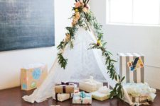07 a lace teepee decorated with greenery and fresh blooms is a cute idea for a boho baby shower