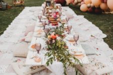 08 a boho baby shower picnic setting with bright florals, balloons and floral pillows for a girl's party