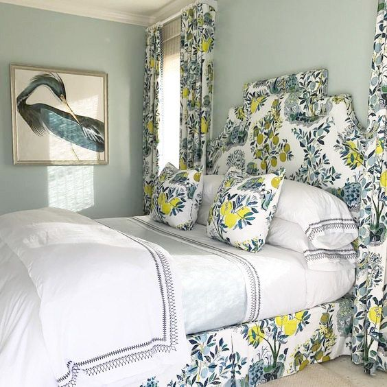 citrus print curtains, pillows and upholstered bed will make your bedroom look bold and bright