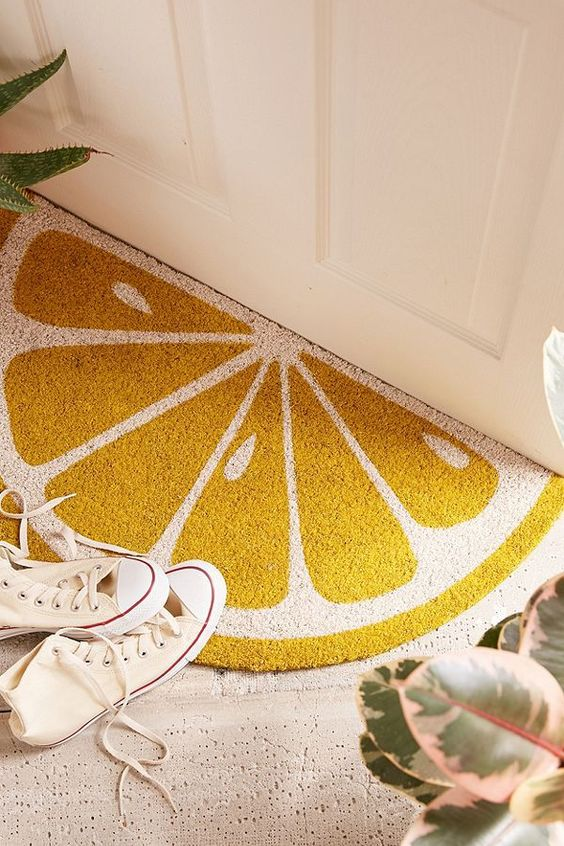 add a citrus rug to your entryway and it will instantly feel bright and summer-like