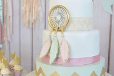 10 a pastel baby shower cake in boho style, with an edible dream catcher and arrows