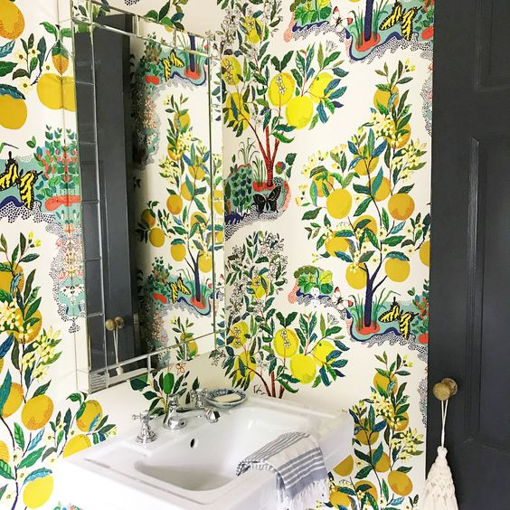 citrus print wallpaper is a very catchy and bold idea for a summer inspired powder room or bathroom