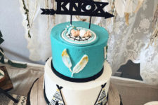 12 a turquoise and white and black baby cake wtih a name topper is a gorgeous idea for a boho shower