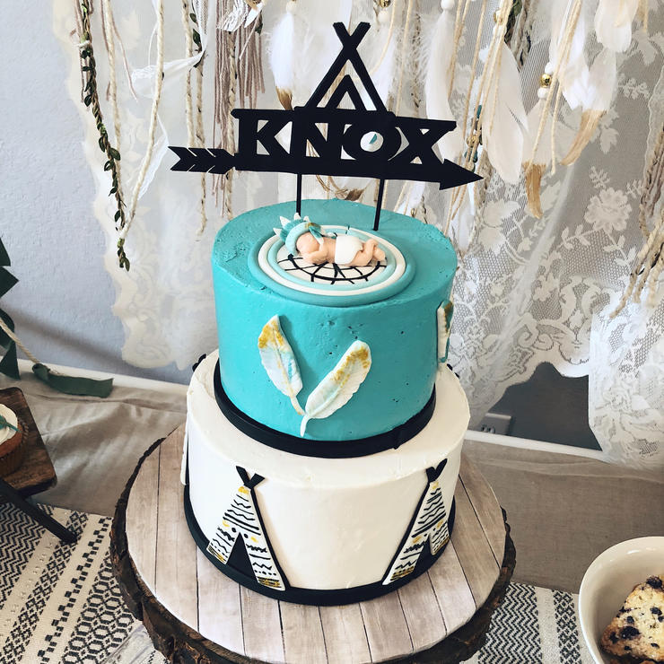a turquoise and white and black baby cake wtih a name topper is a gorgeous idea for a boho shower