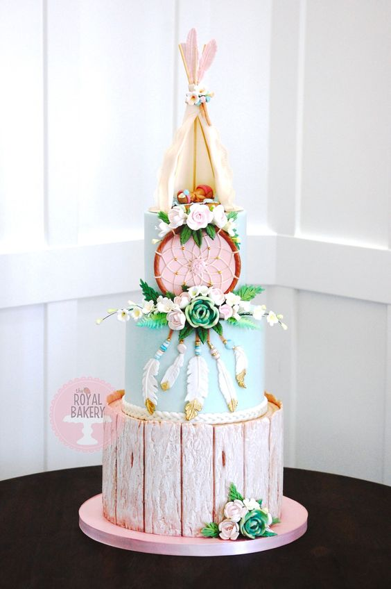 a whimsy pastel baby shower cake with a teepee, a dream catcher and feathers - everything edible
