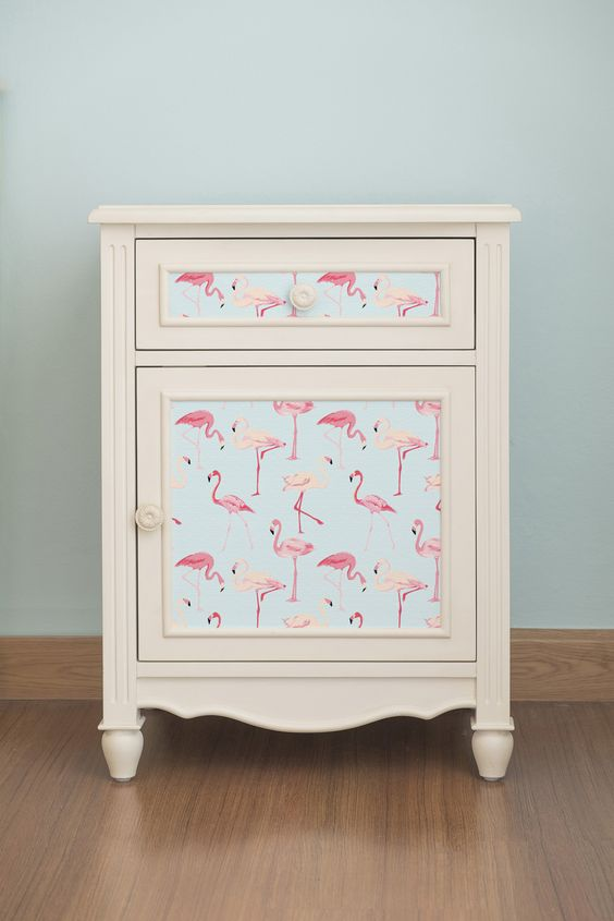 self adhesive, removable wallpaper with a pink flamingo print will make your nightstand more summer inspired