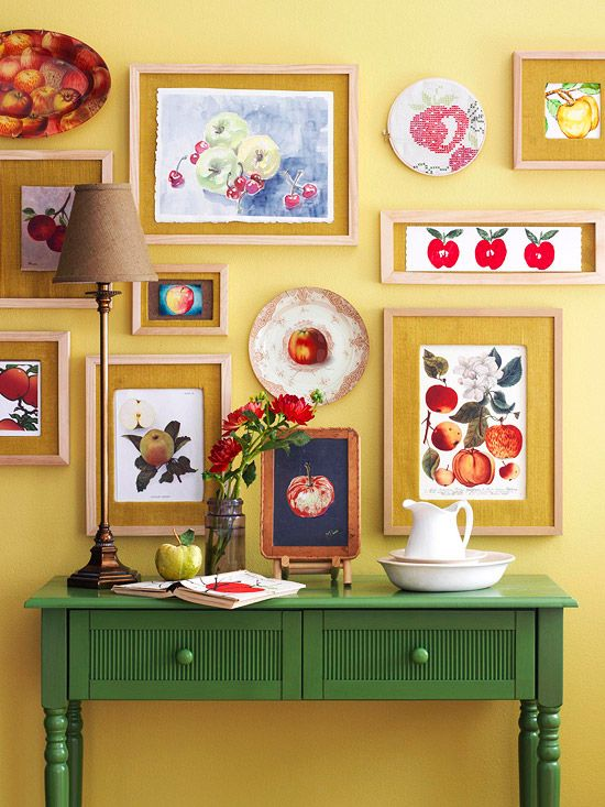 a vintage-inspired gallery wall with artworks showing off fruits is a gorgeous and refiend idea to bring summer to your space