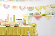 Fiesta birthday party done with paper cacti, colorful banners and garlands and a fringed paper tablecloth