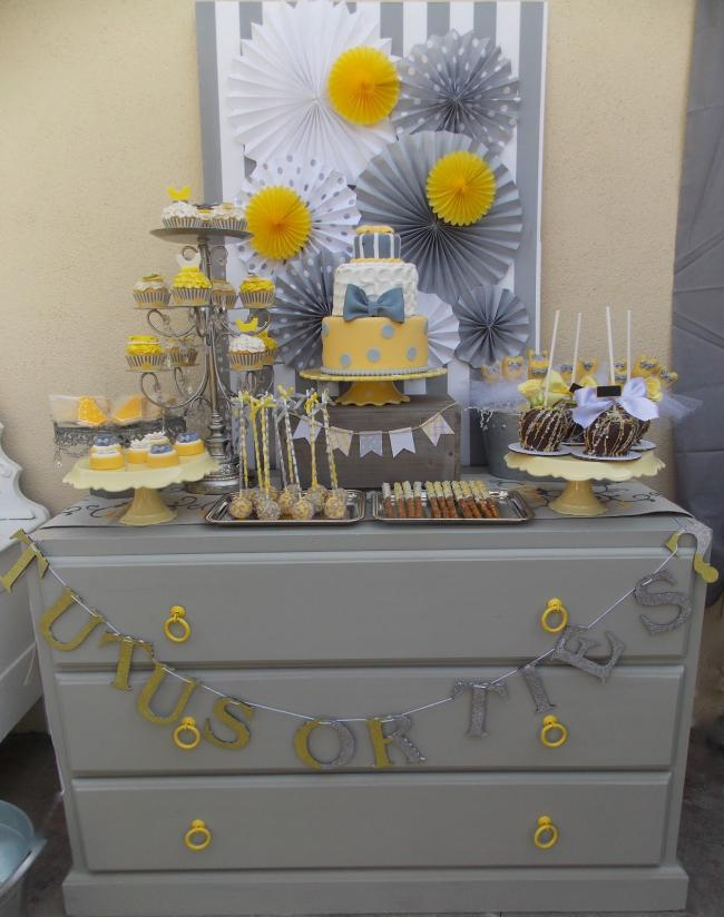 Ties or Tutus is a very cute gender reveal party theme, which can be done in many colors, here in grey and yellow for a more neutral look