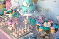 a bright dessert table done for a Little Mermaid birthday party in blues and pink shades