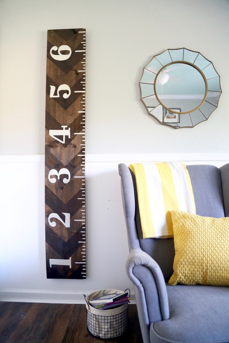 DIY rustic growth chart with white numbers