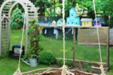 DIY butterfly feeder using pebbles and a vine wreath
