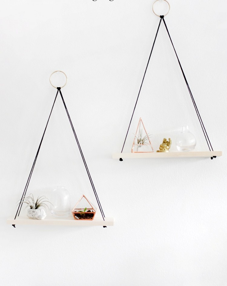 DIY boho hanging shelves with rings and black cords (via www.shelterness.com)