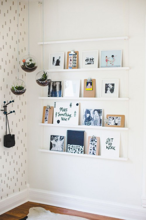 DIY hanging shelving unit of wooden ledges (via www.shelterness.com)