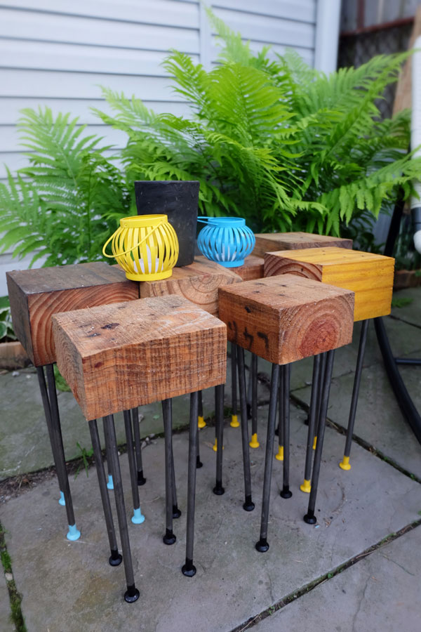 DIY wood and metal patio tables with colorful legs